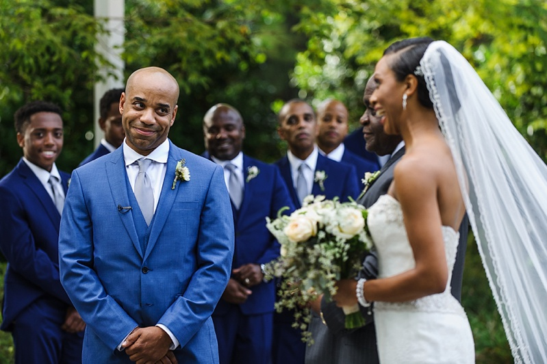 groom seeing his bride for the very first time